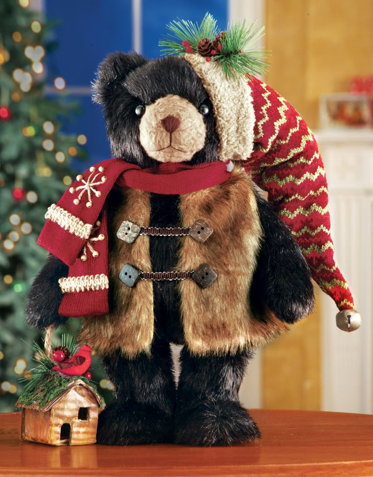 Northwoods Standing Holiday Bear,is decked out in his seasonal finest, this beautiful black bear is a wonderful addition to your Northwoods décor. He wears a faux fur vest, red scarf and stocking hat decorated with berries and pinecones. He carries a tiny birdhouse accented with a cardinal on top. Polyester, pinecones, plastic. For display only, not a toy. 16″H. http://kittykatkoutique.com/northwoods-standing-holiday-bear/