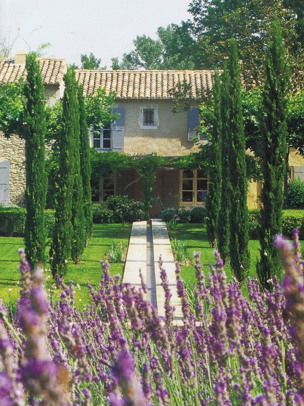 Stone mas (house). French blue shutters. Tiled roof and soffit detail. Cypress trees. Lavender. Sunshine. {from Vicki Archer's restored farmhouse}