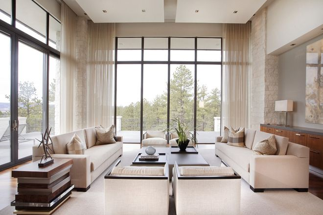 Awesome living room/family room space ! Love the ceiling to floor windows !