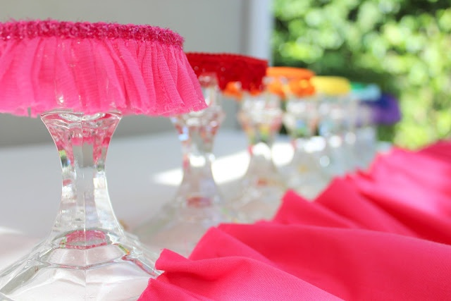 Little cupcake stands... could also use this idea for cake stands, to dress them up. The rainbow theme fits perfectly with an art party!