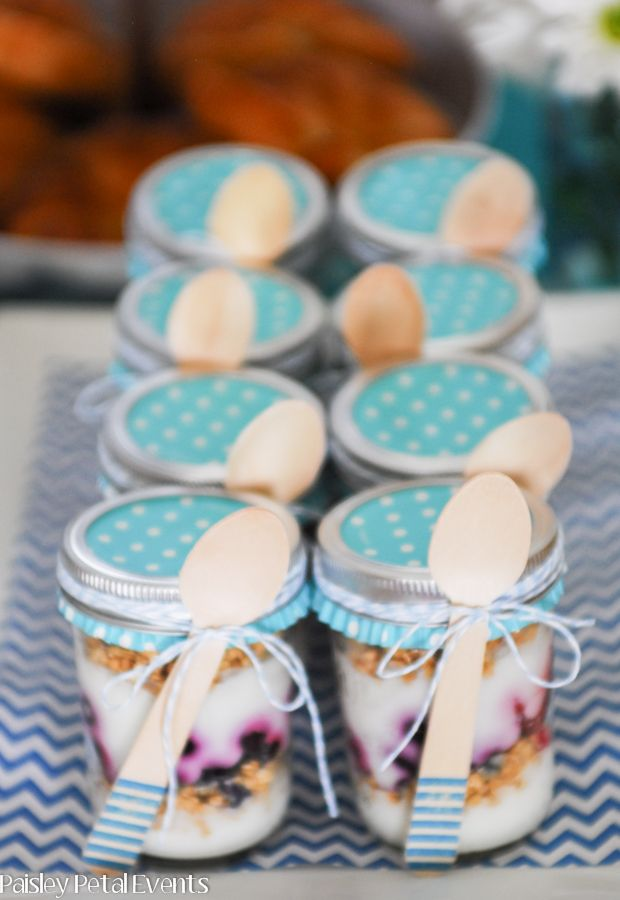 mason jar Baptism Brunch yogurt parfaits with wood spoons! Use coordinating muffin wrappers
