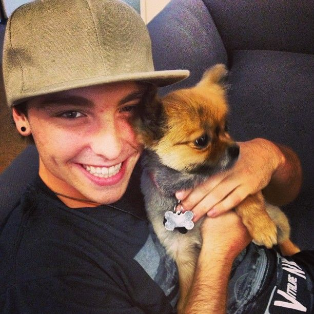 Wes with a puppy. This photo is more than I can handle! His face, and smile!!!!!