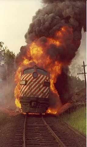 It pisses me off when people post awesome pics like this with absolutely no context. Now doesn't it drive you crazy to NOT KNOW why this frickin locomotive is steaming down the track on fire??? It sure drives ME crazy.