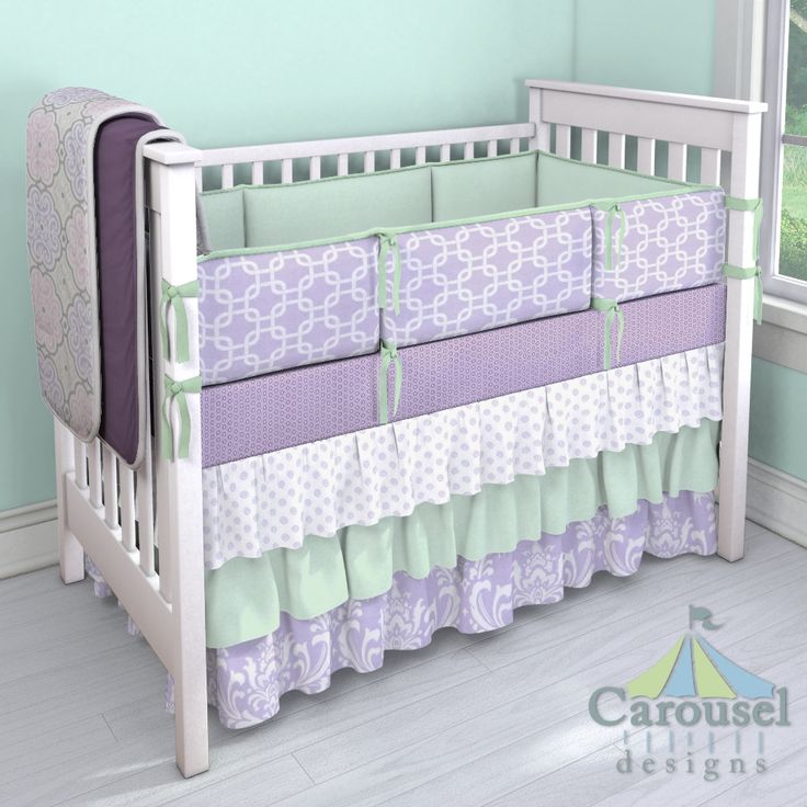 WANT IT!Crib bedding in Lilac Chelsea, Solid Icey Mint, Lilac Osborne Damask, Purple Dots, Lilac Geometric, Solid Mint, Solid Aubergine Purple, Lilac and Pink Nyle. Created using the Nursery Designer® by Carousel Designs where you mix and match from hundreds of fabrics to create your own unique baby bedding. #carouseldesigns