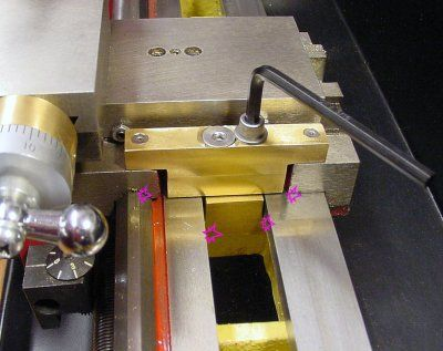homemade metal lathe. homemade carriage lock for a lathe constructed from brass stock and steel screws. metal