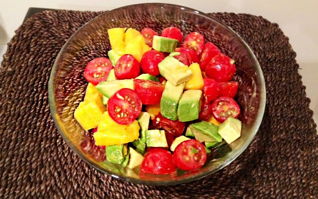 Mango Avocdao Tomato Salad Ingredients 3 avocados 3 mangoes 3 cups/750 g cherry tomatoes 1/4 cup/60 ml olive oil 2 Tbsp./30 ml lemon juice 2 Tbsp./30 ml raw honey (optional) 2 cloves garlic, minced Sea salt and ground pepper, to taste