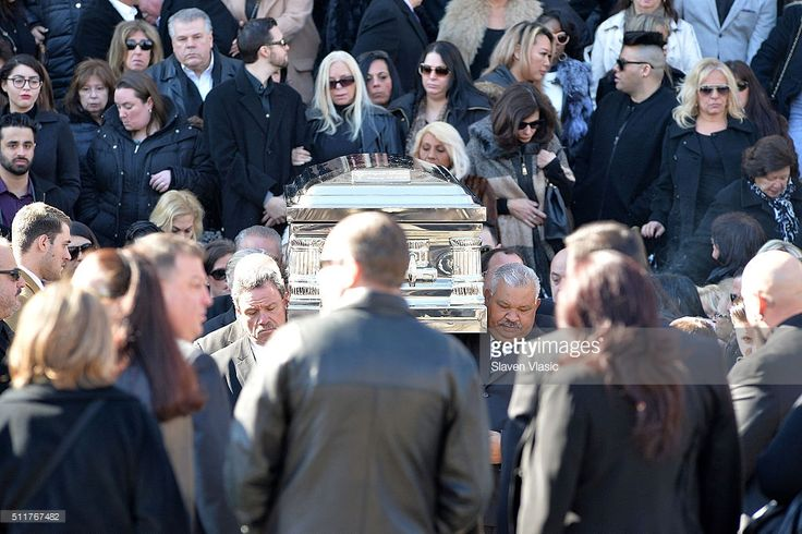 Mourners and family stand by the coffin of Angela 'Big Ang' Raiola during the funeral service held for Angela 'Big Ang' Raiola on February 22, 2016 in New York City. 'Mob Wives' reality star Angela 'Big Ang' Raiola passed away on February 18, 2016 after a battle with cancer.