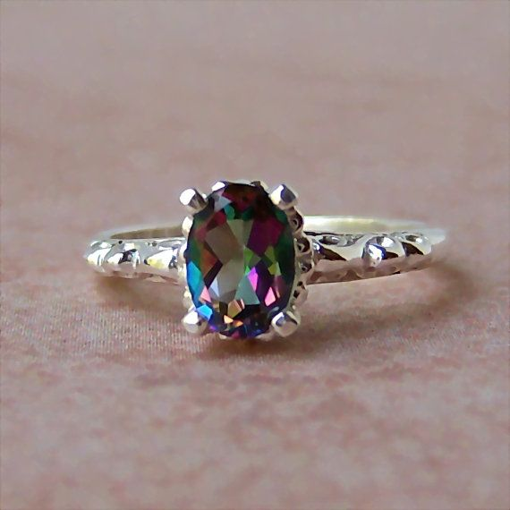 Mystic topaz. My favourite stone. Id take this over diamonds any day
