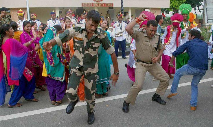BSF jawans and officers dance on the occasion of Raksha Bandhan festival at Indo-Pak Attari-Wagah border. ■ Photo: PTI