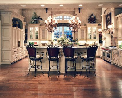Ideal kitchen to work and dine in.  European House Plan # 161104.