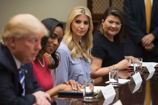 Ivanka Trump Photos Photos - Donald Trump participates in a roundtable with women small business owners at the White House in Washington, DC, March 27, 2017. / AFP PHOTO / JIM WATSON - Donald Trump Participates In Roundtable With Women Small Business Owners