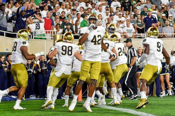 Fighting Irish defensive lineman Julian Okwara (42) gestures to the MSU crowd after Notre Dame scored a touchdown on an interception return in the first quarter. Matt Cashore-USA TODAY Sports