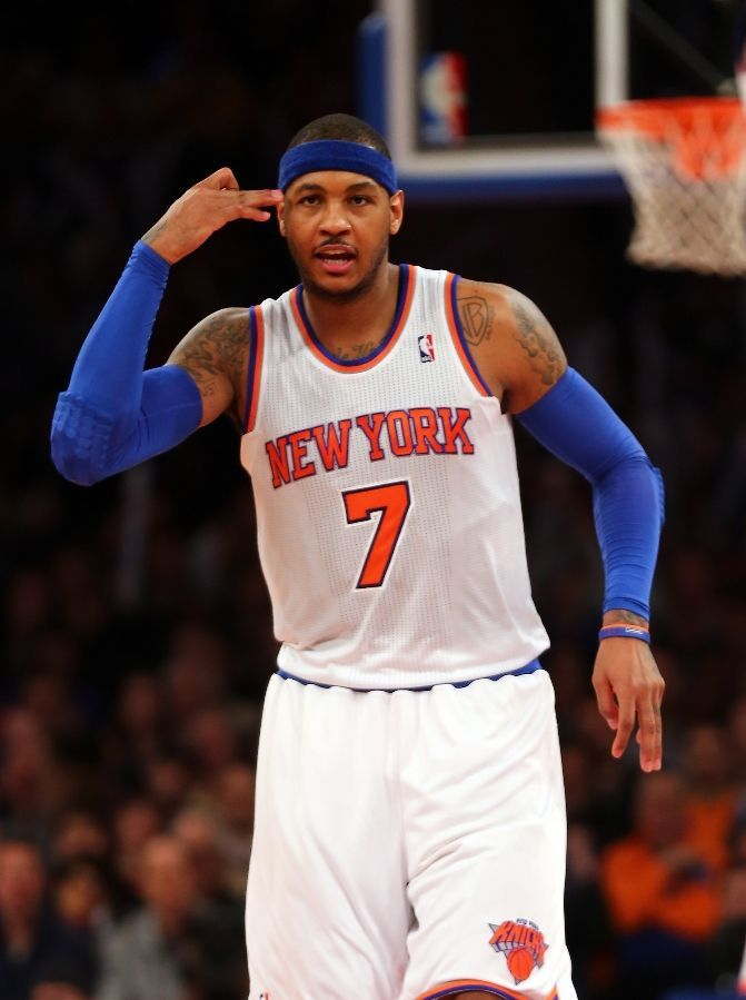 Carmelo Anthony #7 of the New York Knicks celebrates his three point shot in the second half against the Atlanta Hawks on January 27, 2013