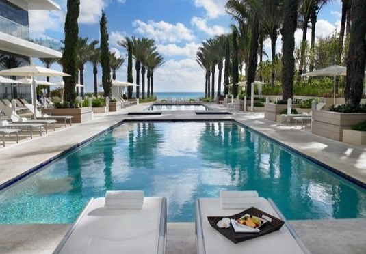 A luxurious suite at an oceanfront hideaway between Miami Beach and Bal Harbor, with a white sand beach