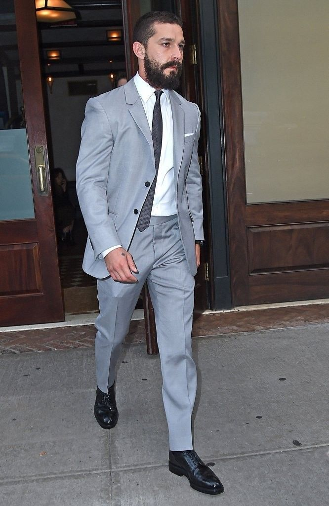 Mr. GQ: Heading out to the screening of 'Fury' on October 14, 2014, Shia LaBeouf was quite the look in a light gray suit, finished with a white dress shirt and black tie.