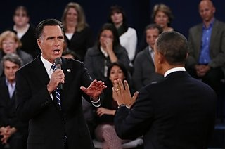 #171 Oct. 17-Obama, Romney Seek Support From Women After Debate;   Republican presidential nominee Mitt Romney, left, addresses President Barack Obama during the second presidential debate at Hofstra University, Tuesday, Oct. 16, 2012, in Hempstead, N.Y. (AP Photo/Pool-Shannon Stapleton)