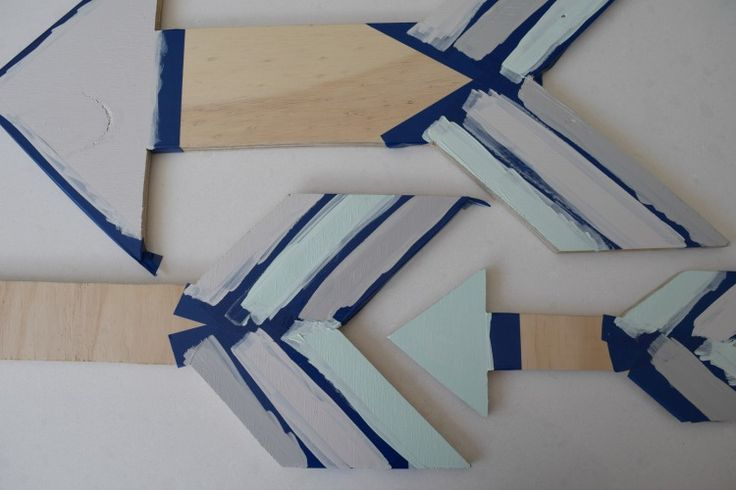 Create patterns on your arrows using masking tape – be creative and try mixing stripes, block colour and other patterns .Paint arrows in two coats of your preferred colours