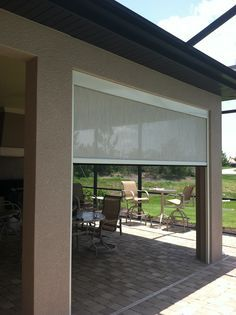 roll screen to enclose patio by marygrove awnings great way to enclose carport without adding a door - Enclosed Outdoor Patio Ideas