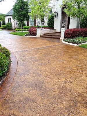 Stained concrete driveway by All American Decorative Concrete - Dallas  When we win the lottery :-)
