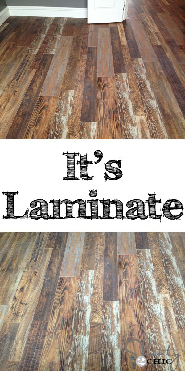Reclaimed wood flooring.  I can't believe this is laminate!!