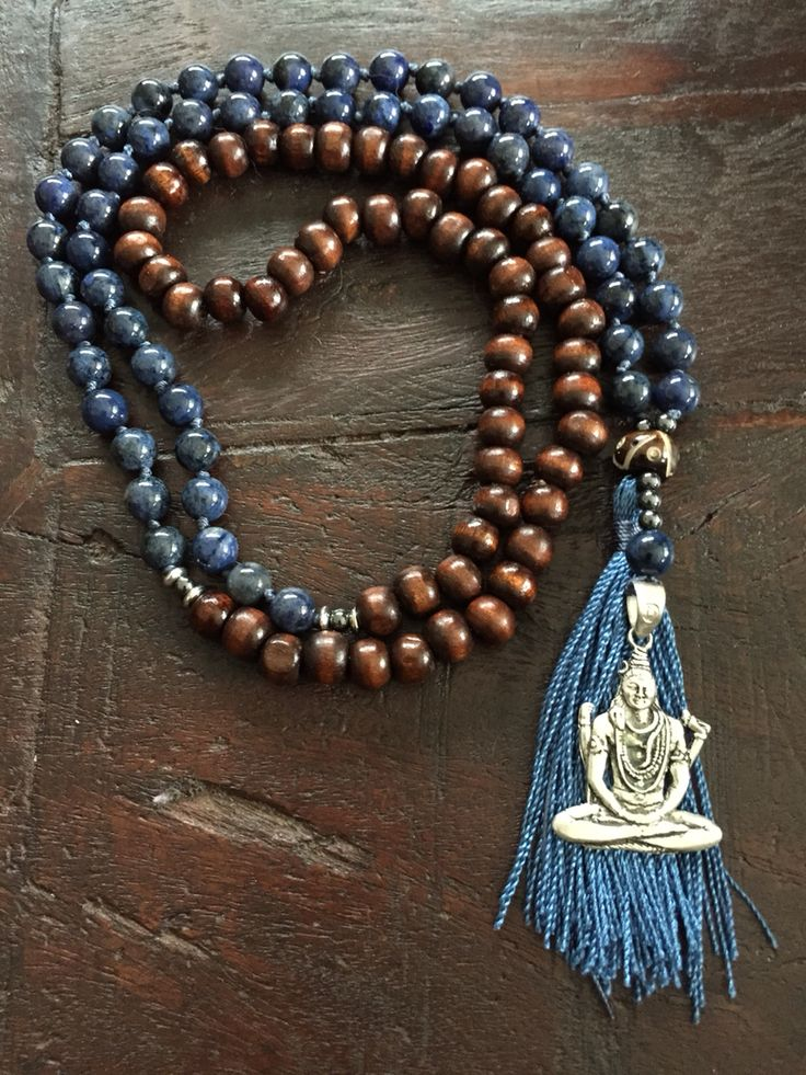 I am Aware Mala. I succumbed to the tassel in this Mala :). Dumortierite brings peace, order & expression. Acting on the third eye it enhances and opens up psychic abilities. Helps one connect with spirit guides and angels. Excellent for peaceful mindfulness or meditation. Brings mental clarity and order and lifts depression. Shiva is the god of the yogis - Shiva stands for letting go of everything in the world of forms. As the old is released  - new opportunities can flow into our lives.