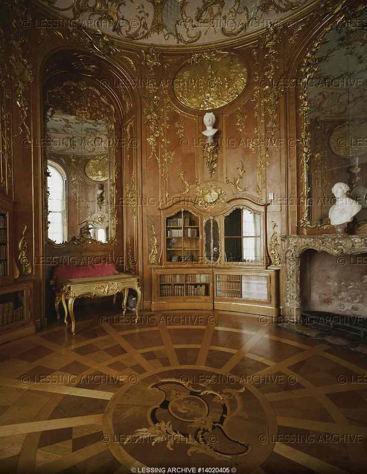 The library of Sanssouci Palace, a circular room with intarsia floor and richly ornamented bookcases. King Frederic II library contained over 2.200 volumes,mainly the works of classical Greek and Roman poets, but also the complete works by French philosopher Voltaire.  Sanssouci, Potsdam, Germany