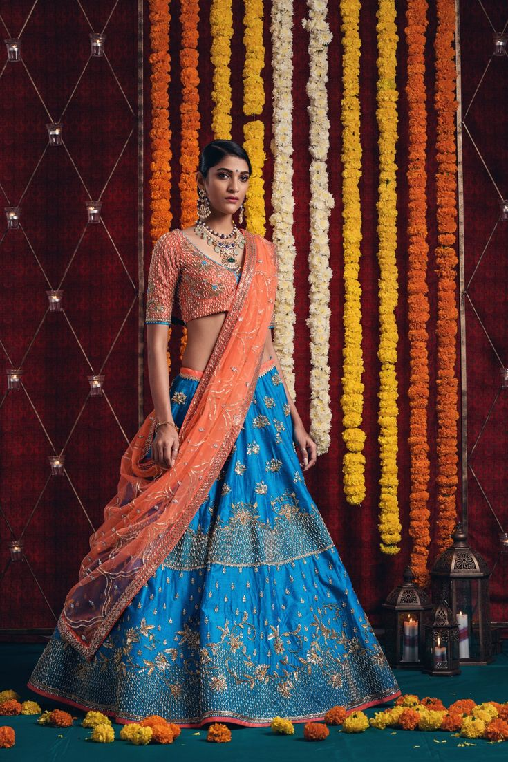 On your wedding day you should look like yourself at your most beautiful. orange and cobalt blue bridal lehenga to bring out the best in you. <br> Jewellery Courtesy: Sitara Jewellery.They can customize the dress as per your requirement. For more details WhatsApp on 9949944178 or mail at info@issastudio.com. 06 February 2018