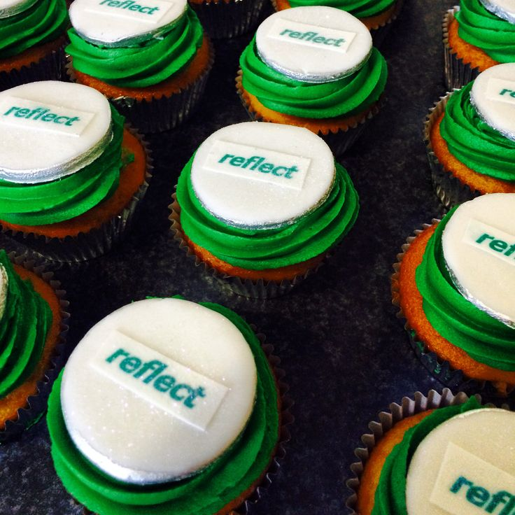 Green cupcakes with fondant disc