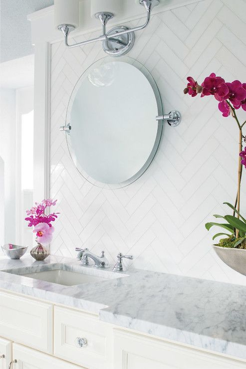 love the white tile in herringbone pattern and marble countertop