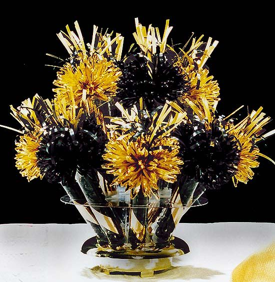 wanderful centerpieces and favors black and gold party