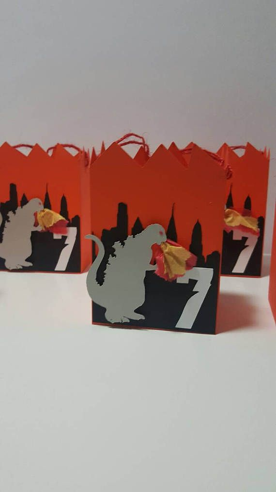These Godzilla inspired favor boxes are great for your little ones celebration. They are personalized with their age. The boxes have twine handles for the children to hold. The flames are made to pop out of Godzillas mouth. There are 5 boxes included in the price.  Colors can be changed. **Need a banner, cupcake toppers, favor bags/tags/boxes, centerpieces or matching items, please contact me.**  Boxes are shipped flat to prevent damage during shipping. They are easy to put together...