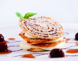 Cordon Bleu - Chocolate-flavored puff pastry crisps with fromage blanc and orange cream, cherry and banyuls wine sauce