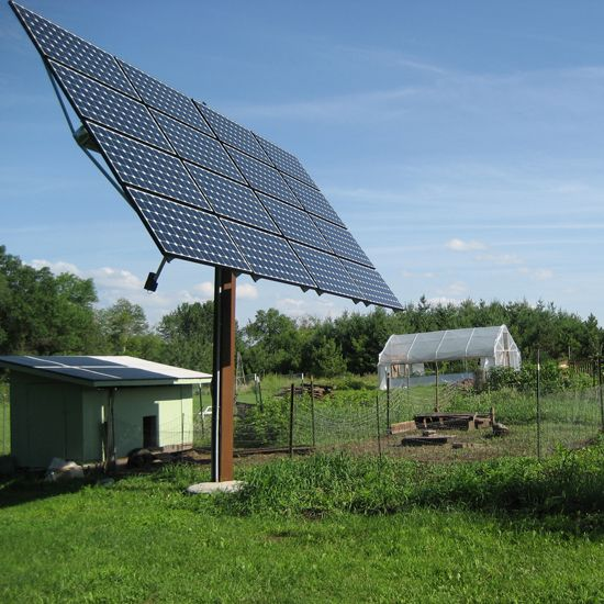 A pole-mounted solar array sited in a sunny spot provides off-grid power to this homestead.