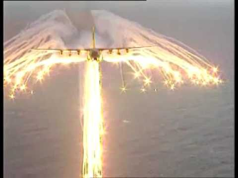 """US Air Force Special Operations. A Lockheed C-130 Dropping Flares in the well known """"angel"""" pattern from the SUU-42A/A Ejector Pods"""