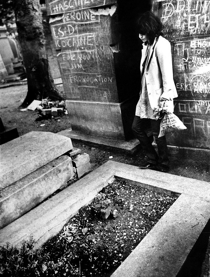 "Patti Smith visiting Jim Morrison's grave in Paris, 1975, by Claude Gassian. ""something new is coming down and we got to be alert to feel it happening. something new and totally ecstatic. the politics of ecstasy move all around me. I refuse to believe Hendrix had the last possessed hand that Joplin had the last drunken throat that Morrison had the last enlightened mind. they didn't slip their skins and split forever for us to hibernate in posthumous jukeboxes."