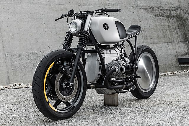 'V05' BMW R80RT - Vagabund. The word 'minimalism' gets thrown around a lot these days. Ever since the rise of the post-WWII art movement of the same name, it seems like every man and his monochromatic dog have become experts on the subject. But I'm here to tell you that despite what you may think, most people don't really know what minimalism actually is. 'Less is more!' the...