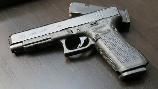 Glock 34 Gen 5 | Competition | Hand guns, Guns, Gears