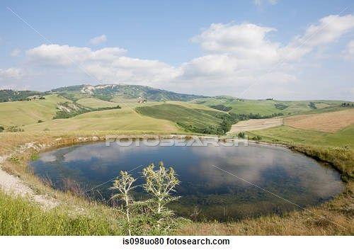 Pond and fields near Volterra, Tuscany, Italy
