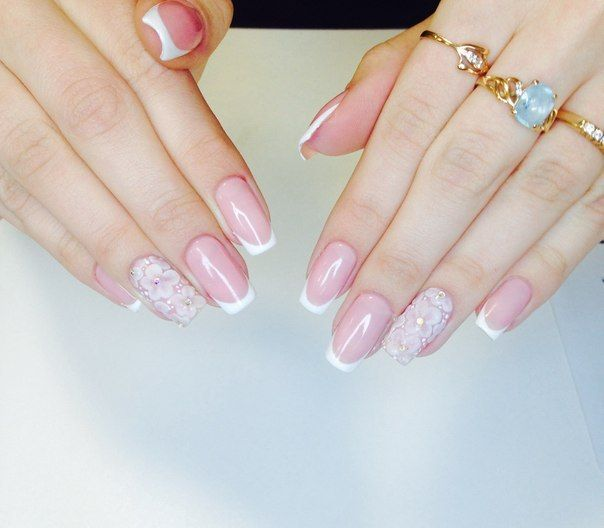 """This manicure is ideal to the girl going to become a bride. Tenderly pink french with perfect white """"smile"""" on the ring finger and the flowers, as if they"""