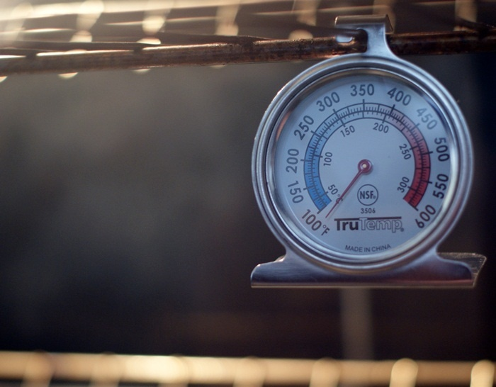 Get an oven thermometer to make sure your oven temperature is correct.  Also, use 'the bread test' to see if your oven has any hot spots.  Great tips from Bake at 350!!