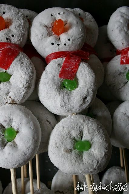 Snowmen on a skewer ~ Use mini powdered sugar doughnuts, an orange Mike & Ike for the nose and a green Mike & Ike cut in half for the buttons. A slice of fruit roll-up makes up the scarf, and the eyes and mouth are made from a toothpick dipped in black food coloring and then touched onto the doughnut.