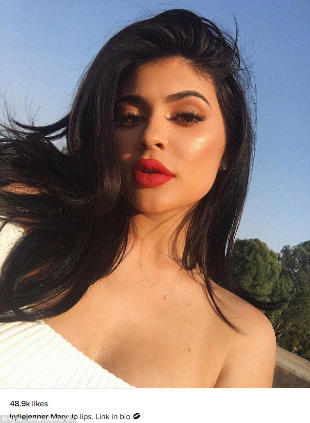 Classic red: Kylie, who has admitted to having lip fillers in the past, plugged her lip kit line in another Instagram post