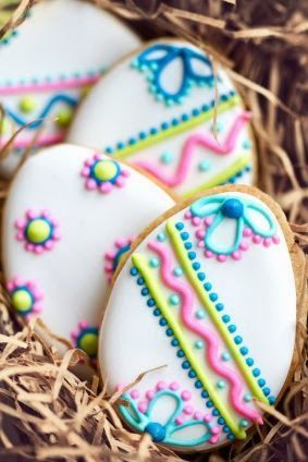 Pretty Decorated egg shaped sugar cookies with icing patterns - spring themed afternoon tea or Easter cakes and baking inspiration for edible gift idea