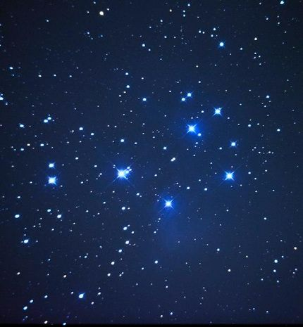 The Pleiades star cluster, also known as the Seven Sisters, marks the radiant for the North Taurid meteor shower.  This cluster is part of the constellation Taurus the Bull.  Photo by Dave Dehetre on Flickr.