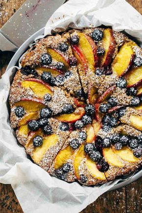 Blueberry Peach Cake recipe - simple ingredients, whole wheat, no refined sugar, and STUNNING presentation. Perfect for summer breakfasts or brunches!   pinchofyum.com