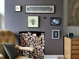 Living Room Fireplace with Gray Walls, Artwork and Armchair