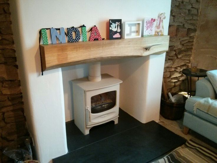 Charnwood C5 Woodburning stove on riven slate hearth. English oak beam finishes off our cottage fireplace transformation.