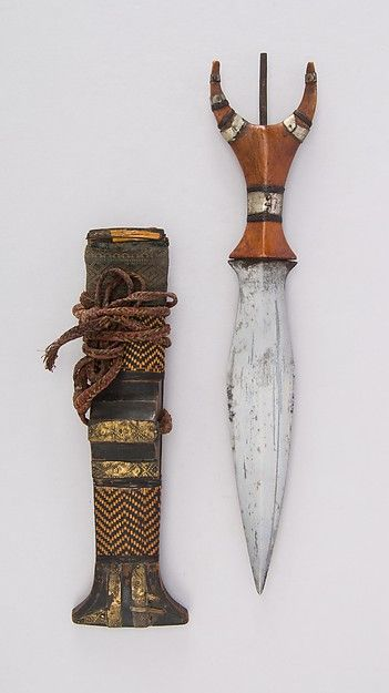 Dagger with Sheath Date: 19th century Culture: Philippine, Mandaya Medium: Steel, wood, cane (rattan), textile, brass, leather, twine MET