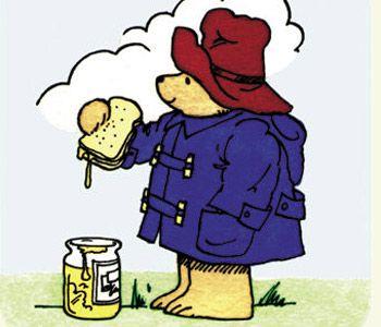 Paddington Bear eating one of his marmalade sandwiches