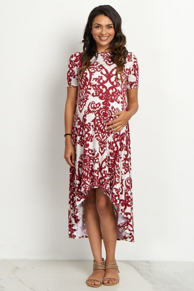 A regal damask print will make you feel like a queen in this dress! A short sleeve maternity dress with a hi-low hemline that will keep you cool in the warm weather this year. Style this gorgeous dress with your favorite sandals and add a belt for cinched effect.
